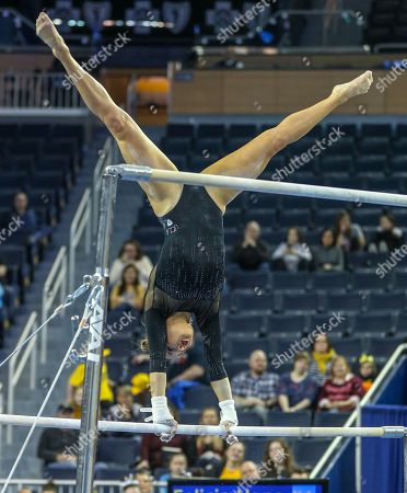 UCLA's Madison Kocian performs on the uneven parallel bars during Round 2 of the NCAA Gymnastics Ann Arbor Regional at Crisler Center in Ann Arbor, MI