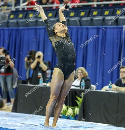 UCLA's Madison Kocian lands her beam dismount during Round 2 of the NCAA Gymnastics Ann Arbor Regional at Crisler Center in Ann Arbor, MI