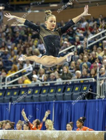 UCLA's Madison Kocian performs on the balance beam during Round 2 of the NCAA Gymnastics Ann Arbor Regional at Crisler Center in Ann Arbor, MI