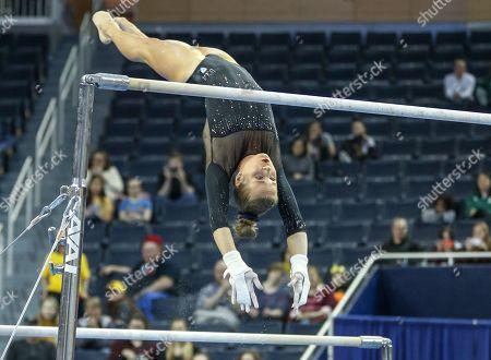 UCLA's Madison Kocian transitions on the bars during Round 2 of the NCAA Gymnastics Ann Arbor Regional at Crisler Center in Ann Arbor, MI