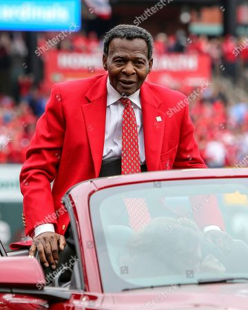 Former St. Louis Cardinals great Lou Brock rides around the warning track prior to the Cardinals home opener baseball game against the San Diego Padres, in St. Louis