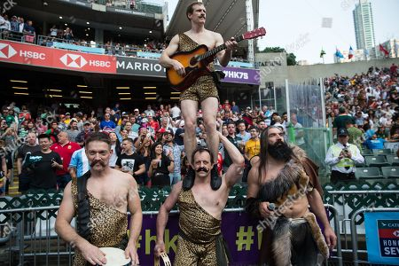 French former rugby union player Sebastien Chabal, (R), and a group of performers dressed as a caveman arrive on the pitch before a performance during the Hong Kong Sevens in Hong Kong, China, 05 April 2019 (issued 06 April 2019). Chabal is in Hong Kong for an advertising campaign during the Sevens tournament.