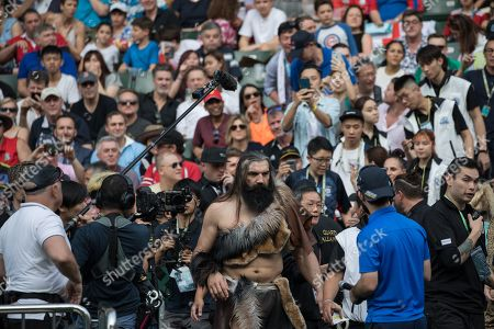 French former rugby union player Sebastien Chabal, (C), dressed as a caveman arrives on the pitch before a performance during the Hong Kong Sevens in Hong Kong, China, 05 April 2019 (issued 06 April 2019). Chabal is in Hong Kong for an advertising campaign during the Sevens tournament.