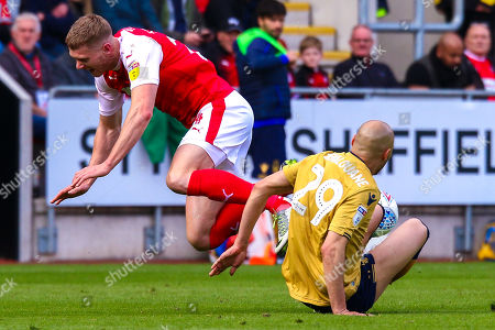 Yohan Benalouane of Nottingham Forest slides in to tackle Michael Smith of Rotherham United