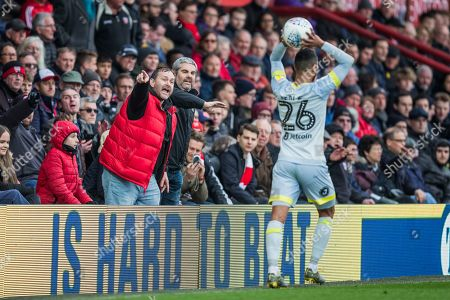 Brentford FC supporters shouting and gesticulating at Ashley Cole (Derby County) during his throw in during the EFL Sky Bet Championship match between Brentford and Derby County at Griffin Park, London