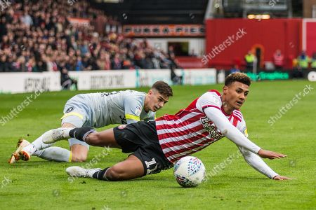 Oliver Watkins (Brentford) falls during a tackle with Tom Lawrence (Derby County) during the EFL Sky Bet Championship match between Brentford and Derby County at Griffin Park, London
