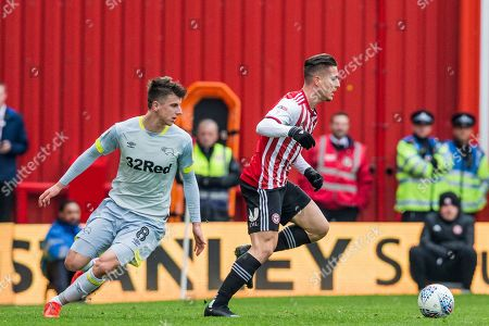 Sergi Canos (Brentford) pursued by Mason Mount (Derby County) during the EFL Sky Bet Championship match between Brentford and Derby County at Griffin Park, London