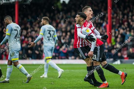 Sergi Canos (Brentford) congratulates Said Benrahma (Brentford) following his goal during the EFL Sky Bet Championship match between Brentford and Derby County at Griffin Park, London