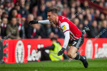 Sergi Canos (Brentford) falling to the ground during the EFL Sky Bet Championship match between Brentford and Derby County at Griffin Park, London