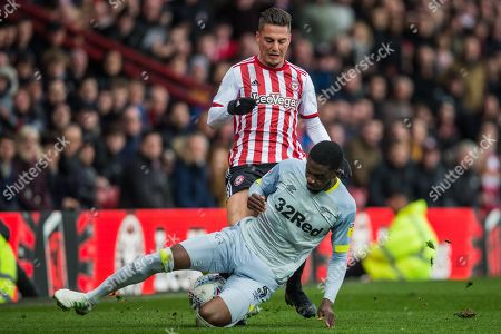 Sergi Canos (Brentford) in a tackle with Fikayo Tomori (Derby County) during the EFL Sky Bet Championship match between Brentford and Derby County at Griffin Park, London