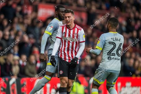 Fikayo Tomori (Derby County) knocks forward Sergi Canos (Brentford) following their tackle during the EFL Sky Bet Championship match between Brentford and Derby County at Griffin Park, London