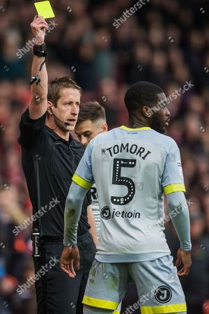 John Brooks (Referee) awarded a yellow card to Fikayo Tomori (Derby County) for his behaviour towards Sergi Canos (Brentford) during the EFL Sky Bet Championship match between Brentford and Derby County at Griffin Park, London