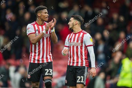Stock Photo of Julian Jeanvier (Brentford) & Said Benrahma (Brentford) thanking Brentford FC supporters following the EFL Sky Bet Championship match between Brentford and Derby County at Griffin Park, London