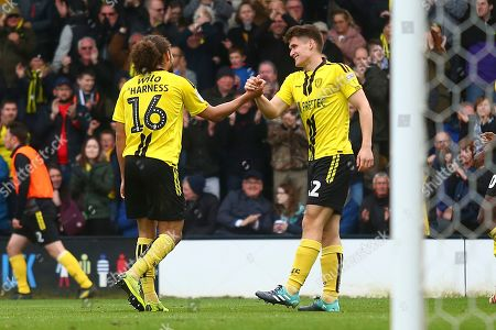 Burton Albion midfielder Marcus Harness (16) scores a goal  and is congratulated by Burton Albion midfielder Ben Fox (12) 3-0 during the EFL Sky Bet League 1 match between Burton Albion and Barnsley at the Pirelli Stadium, Burton upon Trent