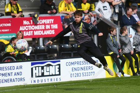 Stock Picture of Burton Albion midfielder William Miller (18) warms up during the EFL Sky Bet League 1 match between Burton Albion and Barnsley at the Pirelli Stadium, Burton upon Trent