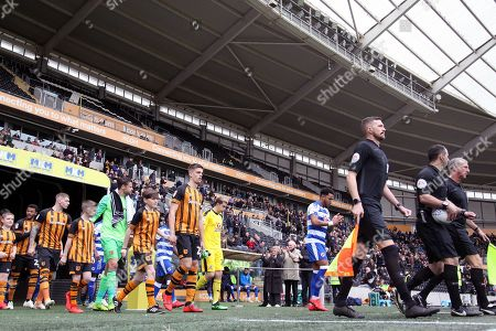 The Referee Mr T Robinson and his Assistants lead the teams out prior to  the EFL Sky Bet Championship match between Hull City and Reading at the KCOM Stadium, Kingston upon Hull