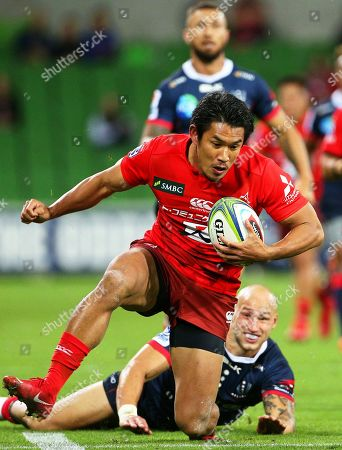 Ryohei Yamanaka (front) of the Sunwolves in action against Bill Meakes (bottom) of the Rebels during the Super Rugby match between the Melbourne Rebels and the Sunwolves in Melbourne, Australia, 06 April 2019.