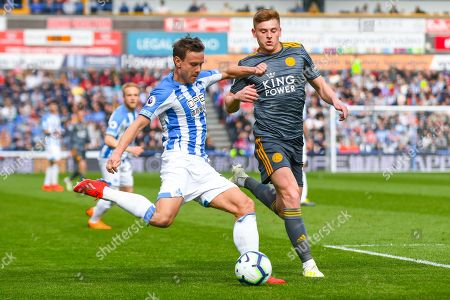 Chris Lowe of Huddersfield Town (15) and Harvey Barnes of Leicester City (19) in action during the Premier League match between Huddersfield Town and Leicester City at the John Smiths Stadium, Huddersfield