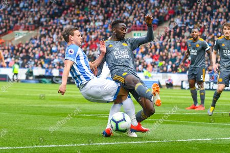 Wilfred Ndidi of Leicester City (25) tackles Chris Lowe of Huddersfield Town (15) during the Premier League match between Huddersfield Town and Leicester City at the John Smiths Stadium, Huddersfield