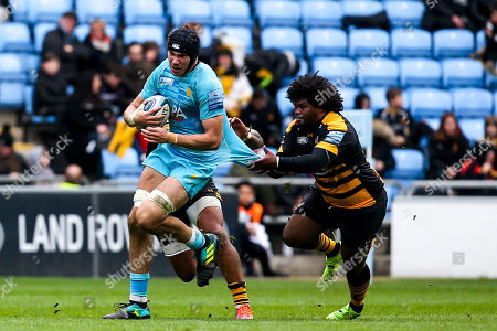 Andrew Kitchener of Worcester Warriors is tackled by Ashley Johnson of Wasps