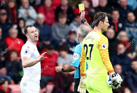 Ashley Barnes of Burnley is shown a yellow card for a tackle on Asmir Begovic of Bournemouth.