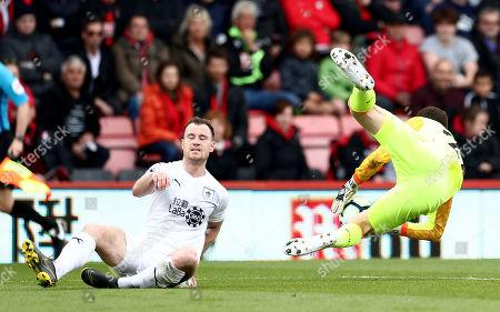 Ashley Barnes of Burnley slides in on Asmir Begovic of Bournemouth.