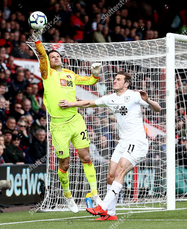 Asmir Begovic of Bournemouth fumbles the ball.