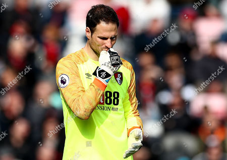 Asmir Begovic of Bournemouth looks dejected.