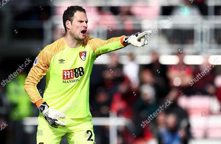 Asmir Begovic of Bournemouth shouts.
