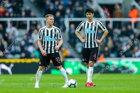 Matt Ritchie (#11) of Newcastle United asnd Ki Sung-Yueng (#4) of Newcastle United stand over a free kick during the Premier League match between Newcastle United and Crystal Palace at St. James's Park, Newcastle