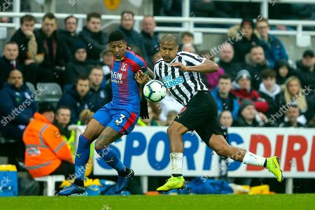 Patrick van Aanholt (#3) of Crystal Palace contests the ball with Jose Salomon Rondon (#9) of Newcastle United during the Premier League match between Newcastle United and Crystal Palace at St. James's Park, Newcastle
