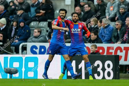 Stock Picture of James Tomkins (#5) of Crystal Palace and Andros Townsend (#10) of Crystal Palace being to celebrate after Crystal Palace put the ball in the net but the goal is ruled offside during the Premier League match between Newcastle United and Crystal Palace at St. James's Park, Newcastle