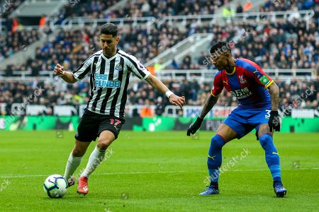 Ayoze Perez (#17) of Newcastle United looks to take on Patrick van Aanholt (#3) of Crystal Palace during the Premier League match between Newcastle United and Crystal Palace at St. James's Park, Newcastle