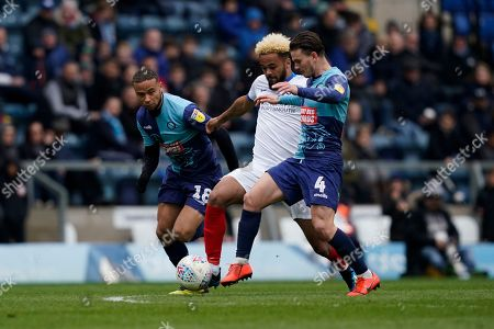 Dominic Gape of Wycombe Wanderers tackles Anton Walkes of Portsmouth during the EFL Sky Bet League 1 match between Wycombe Wanderers and Portsmouth at Adams Park, High Wycombe