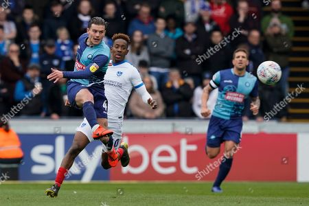 Dominic Gape of Wycombe Wanderers clears the ball during the EFL Sky Bet League 1 match between Wycombe Wanderers and Portsmouth at Adams Park, High Wycombe