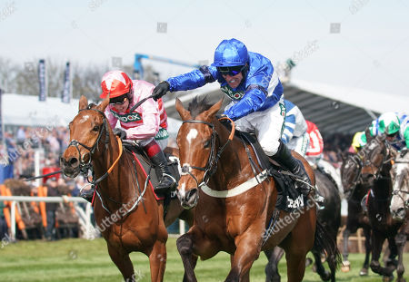 Aintree Racecourse. The Betway Mersey Novices' Hurdle Race. Reserve Park (blue) ridden by Robbie Power wins from Brewinupastorm (star cap) ridden by Richard Johnson.