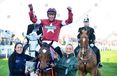 AINTREE. The Randox Health Grand National. TIGER ROLL and Davy Russell are greeted by grooms Karen Morgan (left) and Louise Magee after winning trainer Gordon Elliott.