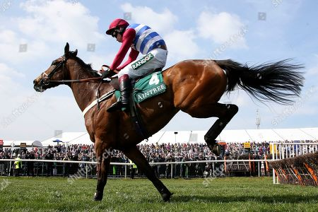 Third placed Keeper Hill ridden by Richard Johnson clears the last in the 1:45pm The Gaskells Handicap Hurdle (Grade 3) during the Grand National Meeting at Aintree, Liverpool