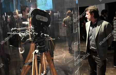 Polish actor Robert Wieckiewicz looks on a film camera at the 'Wajda' exhibition at the National Museum in Krakow, Poland, 05 April 2019 (issued 06 April 2019). The exhibition presents creative achievements of one of the most famous Polish film directors Andrzej Wajda.