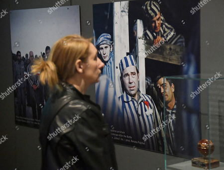 A visitor looks on a picture from Andrzej Wajda movie 'Landscape after the Battle' at the 'Wajda' exhibition at the National Museum in Krakow, Poland, 05 April 2019 (issued 06 April 2019). The exhibition presents creative achievements of one of the most famous Polish film directors Andrzej Wajda.