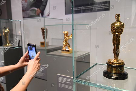A visitor takes a picture of Andrzej Wajda's Oscar Award for Lifetime achievements at the 'Wajda' exhibition at the National Museum in Krakow, Poland, 05 April 2019 (issued 06 April 2019). The exhibition presents creative achievements of one of the most famous Polish film directors Andrzej Wajda.