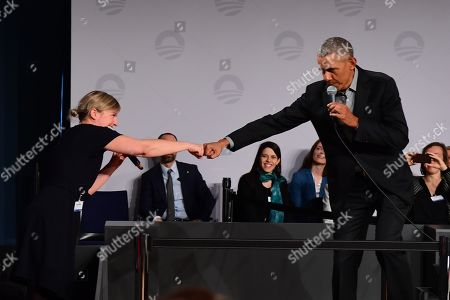 Former US president Barack Obama (R) and the Bavarian Alliance 90/The Greens party faction leader Katharina Schulze greet with their fists during a town hall meeting at the European School of Management and Technology (ESMT) in Berlin, Germany, 06 April 2019. After taking part in a summit in Cologne and a meeting with German Chancellor Angela Merkel, Obama talked to emerging leaders from across Europe in a town hall meeting format during his three day visit to Germany.