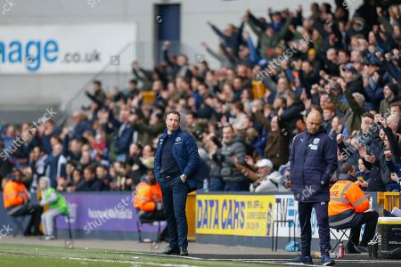 Millwall manager Neil Harries looks towards West Bromwich Albion caretaker manager James Shan after the final whistle is blown in the EFL Sky Bet Championship match between Millwall and West Bromwich Albion at The Den, London