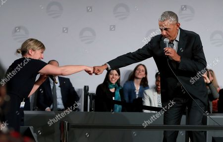Stock Photo of Former US President Barack Obama, right, greets German Green Party member Katharina Schulze, left, during a town hall meeting at the 'European School For Management And Technology' (ESMT) in Berlin, Germany