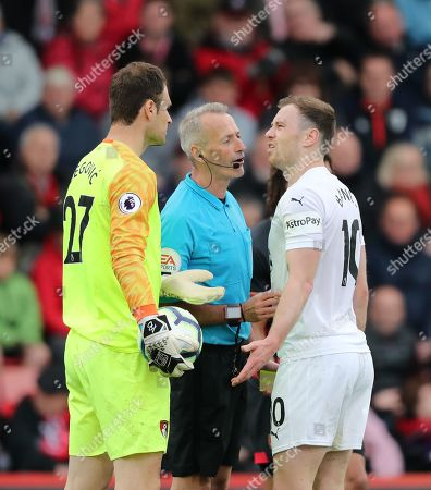 Ashley Barnes of Burnley argues with Goalkeeper Asmir Begovic of Bournemouth after he is awarded a yellow card for a challenge.