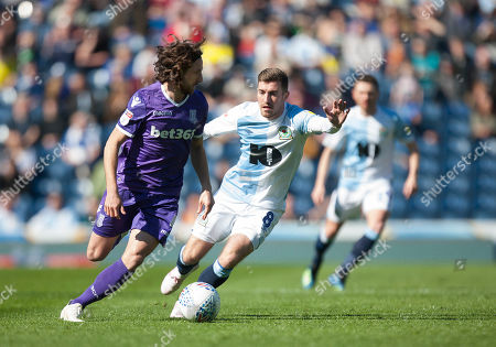 Joe Allen of Stoke City (L) and Joe Rothwell of Blackburn Rovers in action