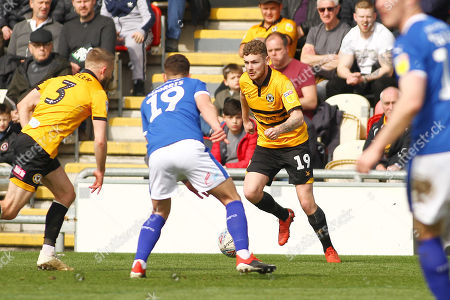 Ben Kennedy of Newport County takes on Kieron Morris of Tranmere Rovers