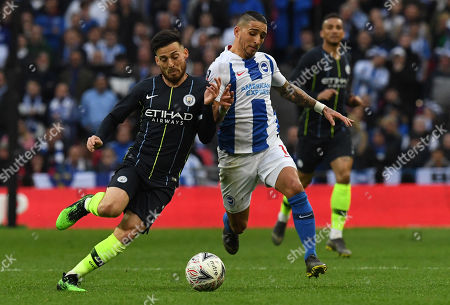 Stock Image of Brighton and Hove's Leon Balogun (R) and Manchester City's David Silva (L) in action during the English FA Cup semi final soccer match  Manchester City vs Brighton and Hove Ablion at Wembley Stadium in London, Britain, 06 April 2019.