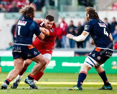 Scarlets vs Edinburgh. Scarlets' Rob Evans is tackled by Pierre Schoeman of Edinburgh