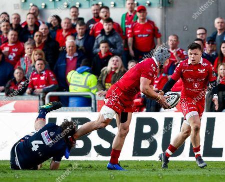 Scarlets vs Edinburgh. Scarlets' Jonathan Davies is tackled by Ben Toolis of Edinburgh